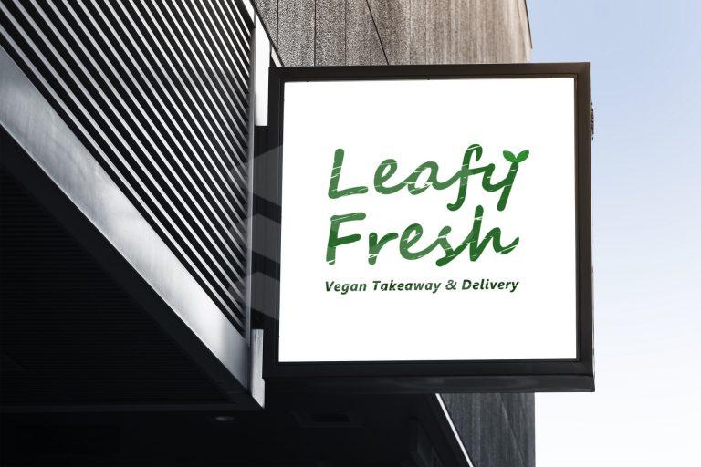 leafy fresh vegan restaurant logo design on store front sign